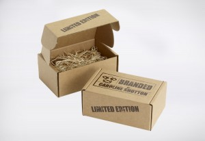 Environmental Product packaging created in Kraft e-flute corrugated and screen printed in dark brown, with the product packed in wood wool.