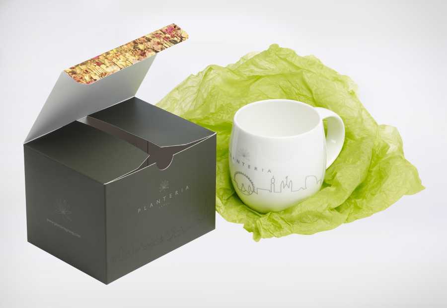 A fine Bone china branded mug, packed carefully in bright green tissue in a fully branded presentation box. First impressions count.